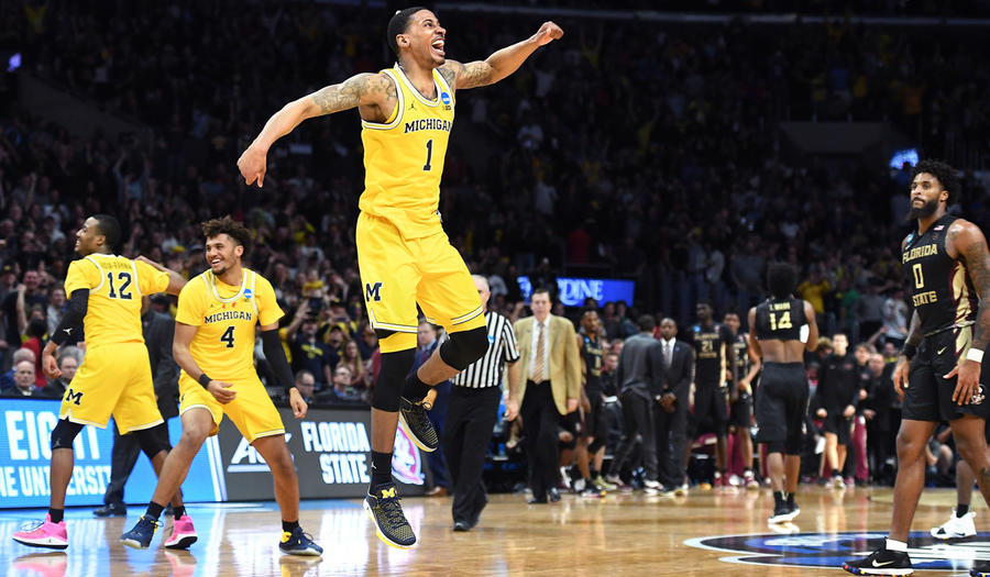 Michigan's Charles Matthews, center, celebrates at the end of the game to defeat Florida State in the regional final of the NCAA tournament. (Wally Skalij / Los Angeles Times)