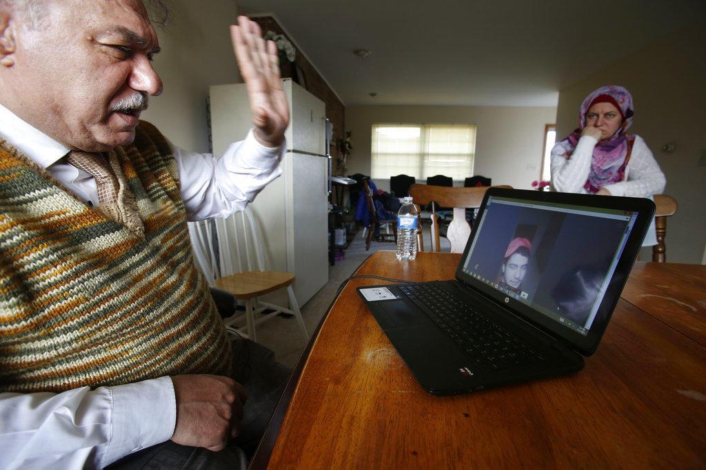 Rifat Moustafa, a Syrian immigrant, greets his 16-year-old son, Hasib Moustafa Rifat
