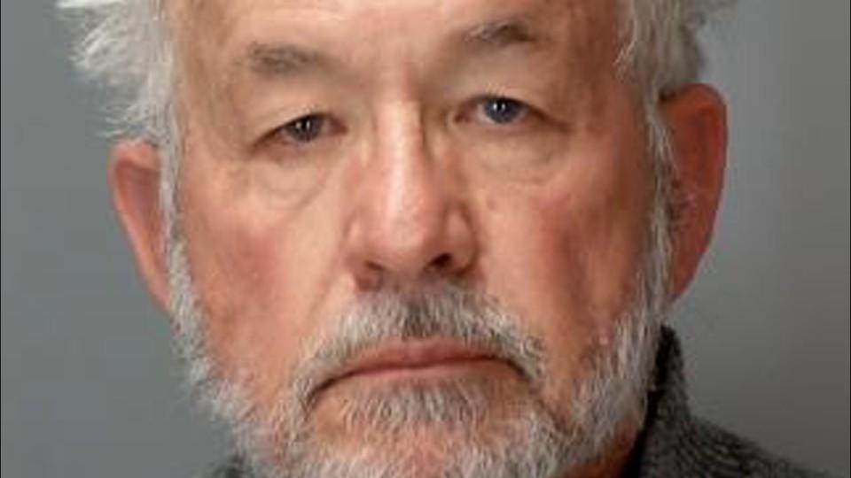 Michigan State ex-dean accused of having students nude photos