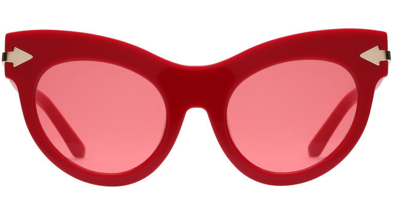 Karen Walker's red acetate Miss Lark sunglasses.
