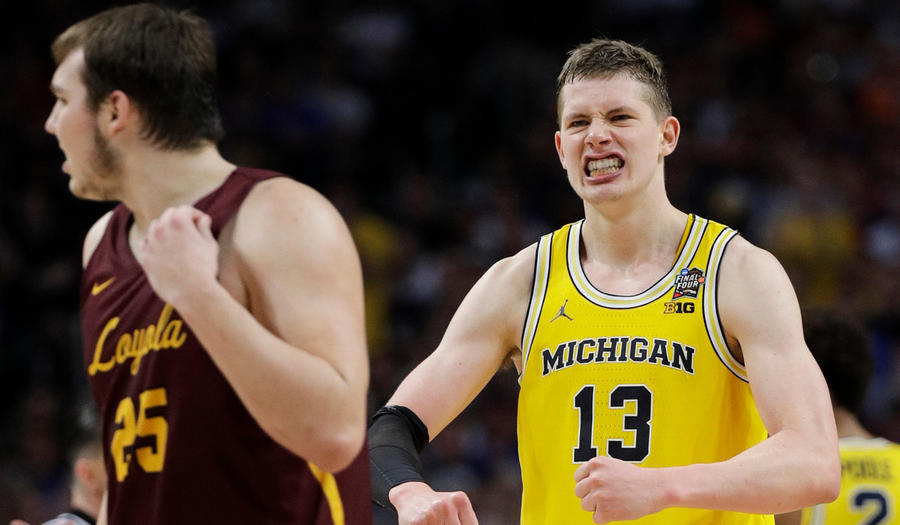 Michigan's Moritz Wagner reacts during the second half in the semifinals of the NCAA tournament against Loyola Chicago on Saturday (David J. Phillip / Associated Press)