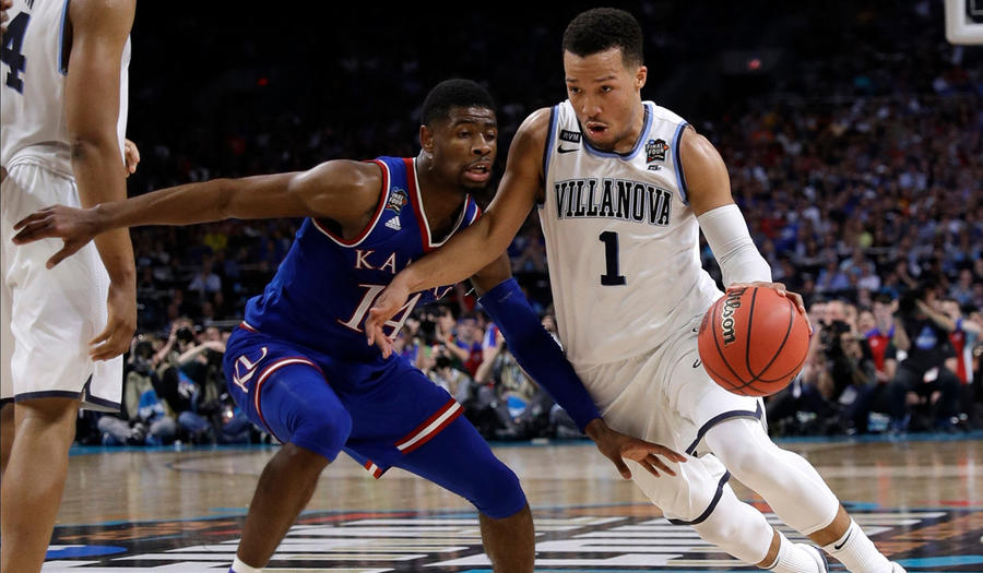 Villanova's Jalen Brunson (1) drives past Kansas' Malik Newman during the second half in the semifinals of the NCAA tournament on Saturday (David J. Phillip / Associated Press)