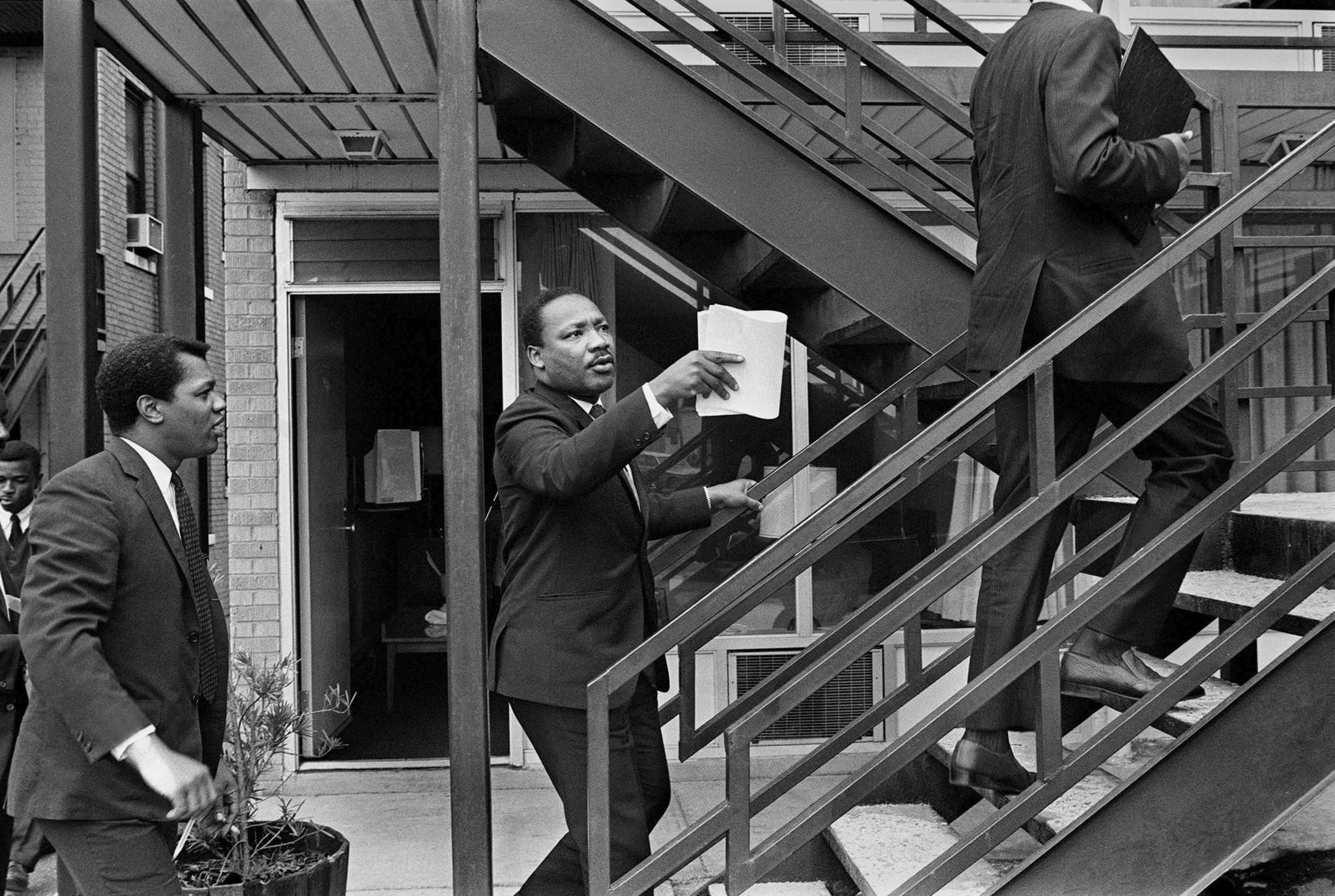 In this April 3, 1968 photo, the Rev. Dr. Martin Luther King Jr., center, and his aides walk at the