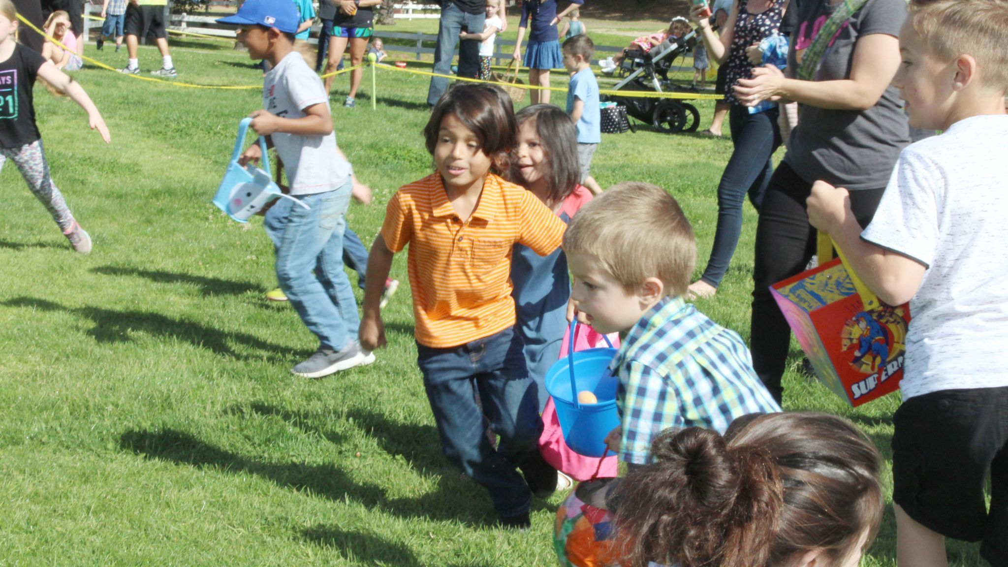 Enthusiastic youngsters rush for the remaining eggs at the end of the egg hunt for 5- to 7-year-olds.