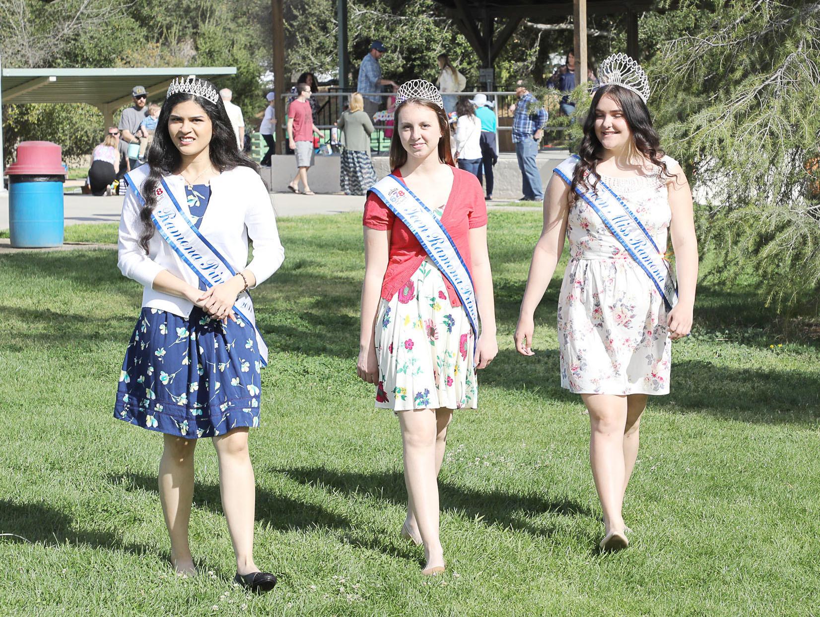 Ramona Princess Mariann Gonzalez-Lopez, Teen Ramona Princess MacKenzie Nolan and Teen Miss Ramona Cheyenne DePhilippis stroll through Ramona Oaks Park as festivities get started.