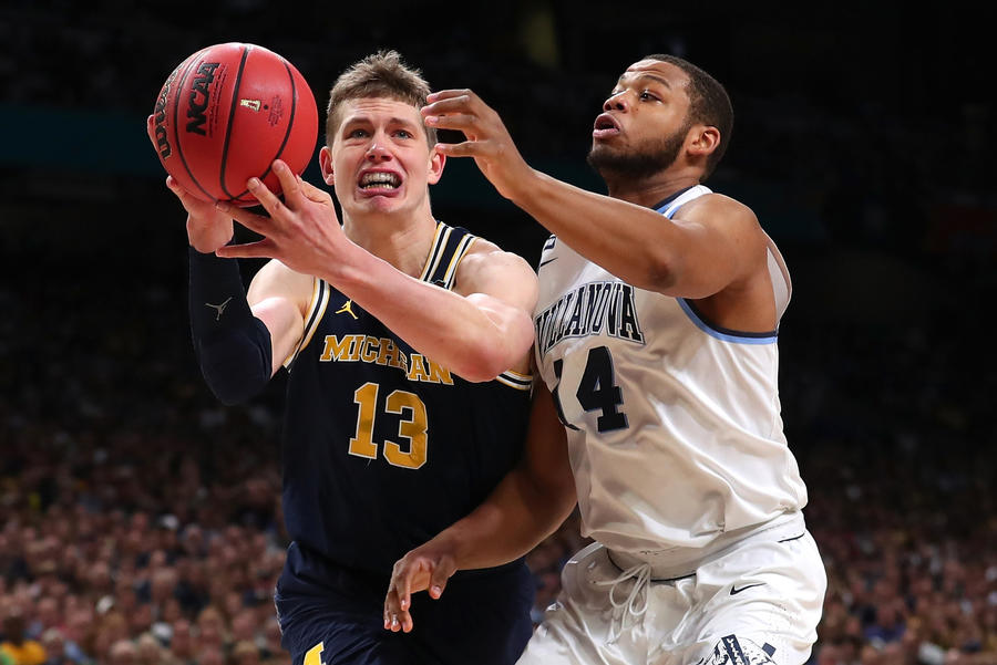 Moritz Wagner #13 of the Michigan Wolverines handles the ball against Omari Spellman #14 of the Villanova Wildcats. (Tom Pennington/Getty Images)