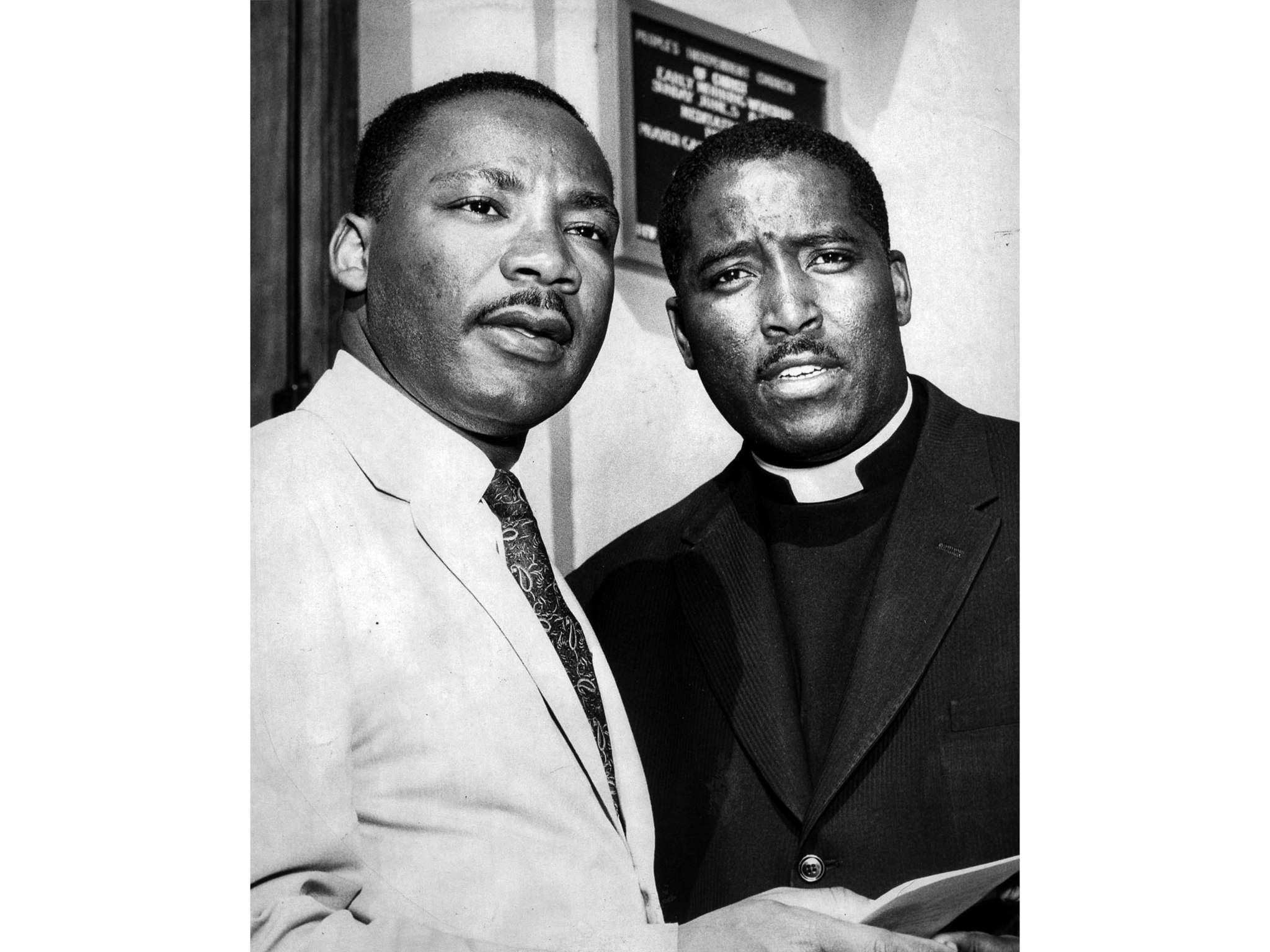 July 9, 1960: Dr. Martin Luther King, left and Rev. Maurice Dawkins, minister of the People's Indepe