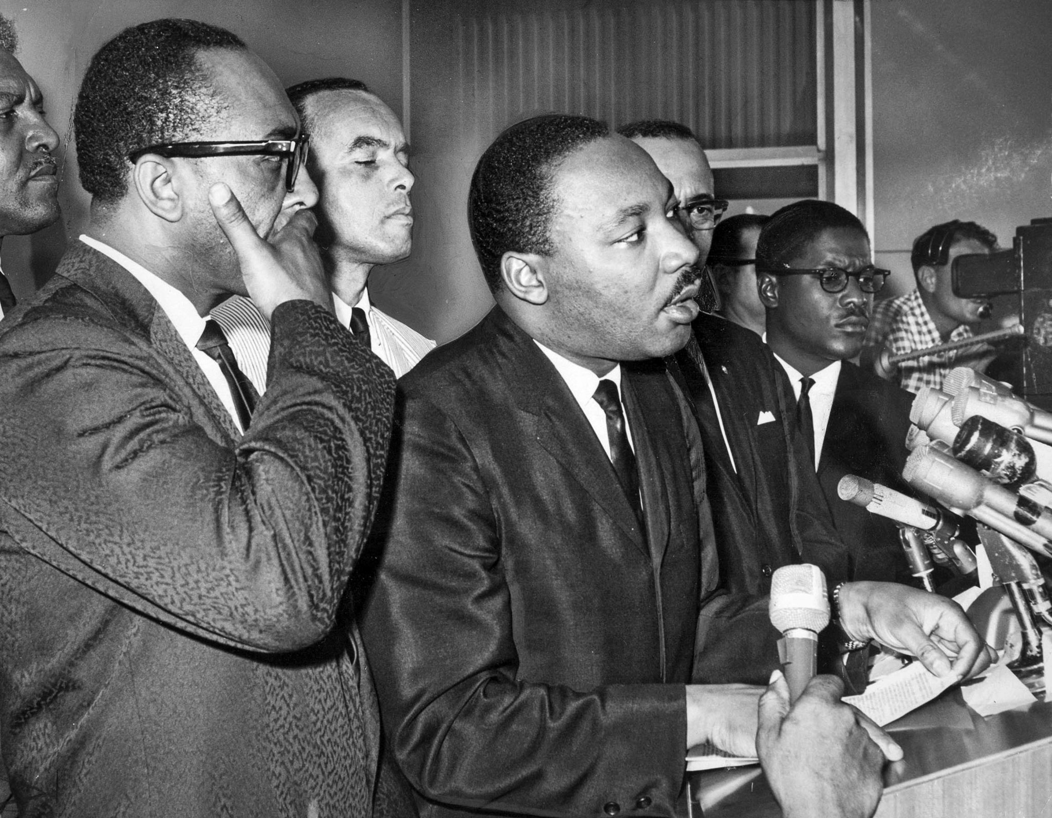 Aug. 17, 1965: Dr. Martin Luther King at podium after arrival at Los Angeles International Airport.