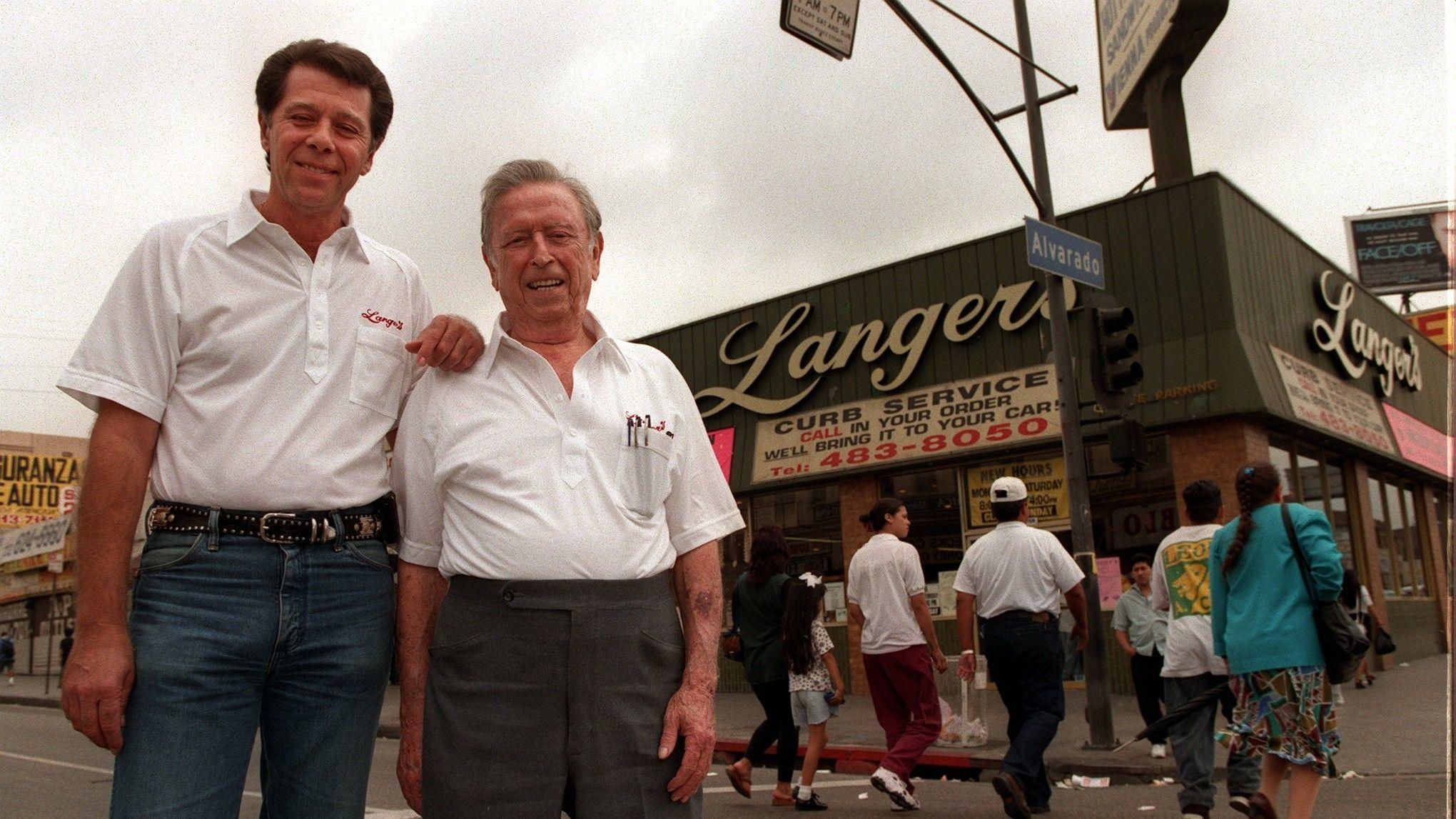 Norm Langer, left, with father Al Langer in front of Langer's Deli in 1997.
