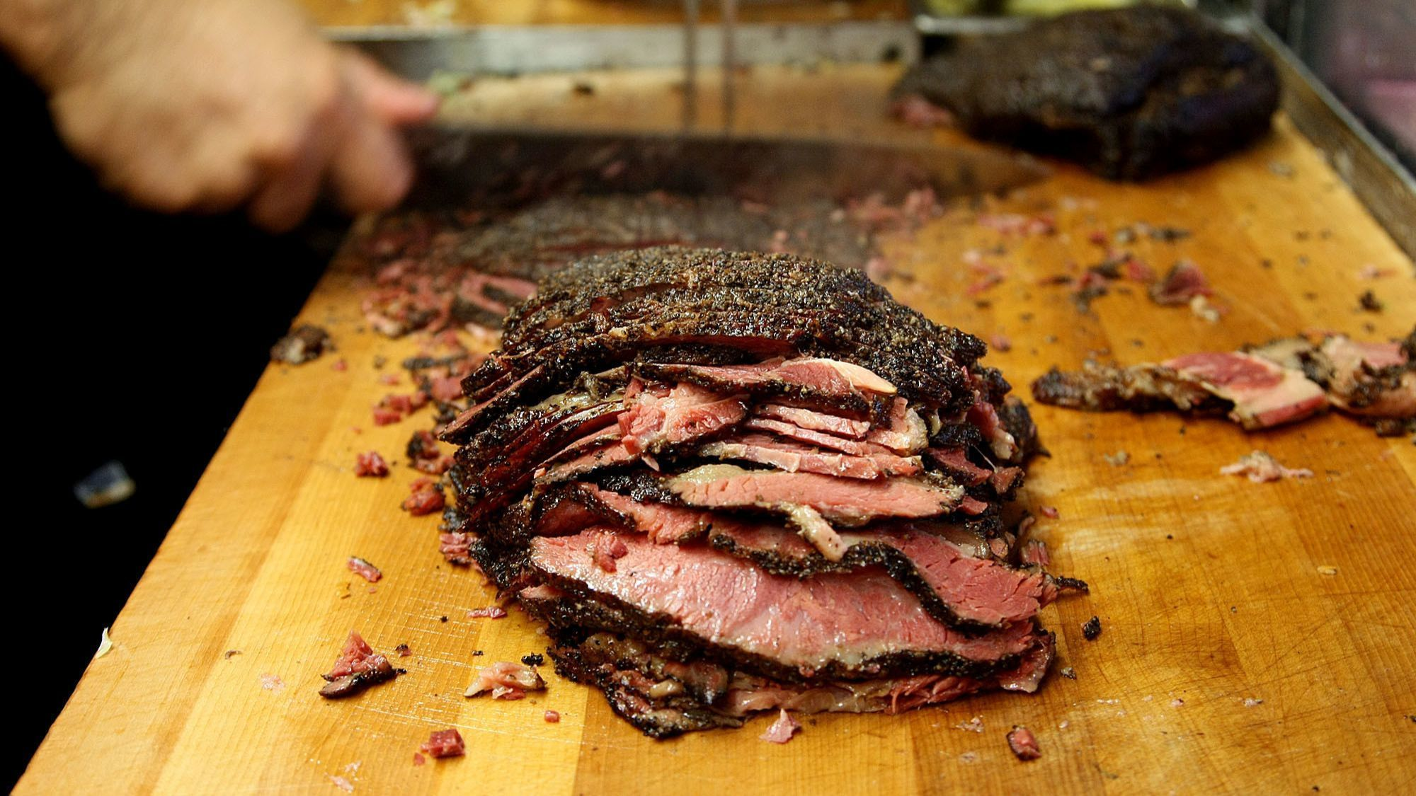 Pastrami is sliced to make some of Langer's signature #19 sandwiches in 2012.