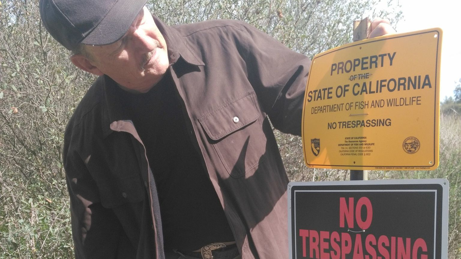 """Ramona residents Ed Sapeth and John Degenfelder are frustrated that """"No Trespassing"""" signs prevent the public from using at least part of Canada de San Vicente property for hikin"""