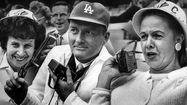 From the Archives: 1965 Dodgers fans listen to Vin Scully during Angels game
