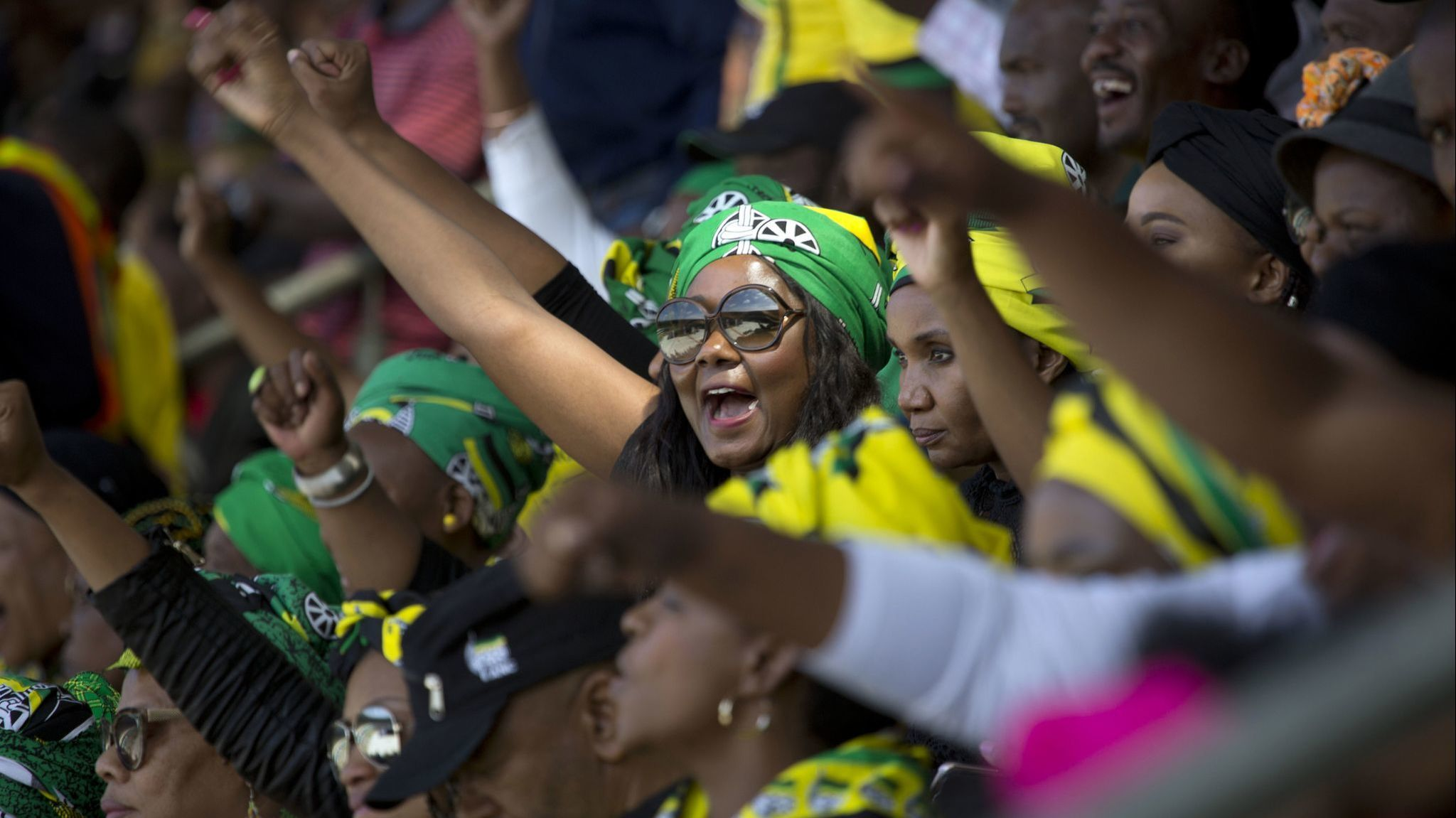 ANC supporters celebrate the legacy of anti-apartheid icon Winnie Madikizela-Mandela during her fune
