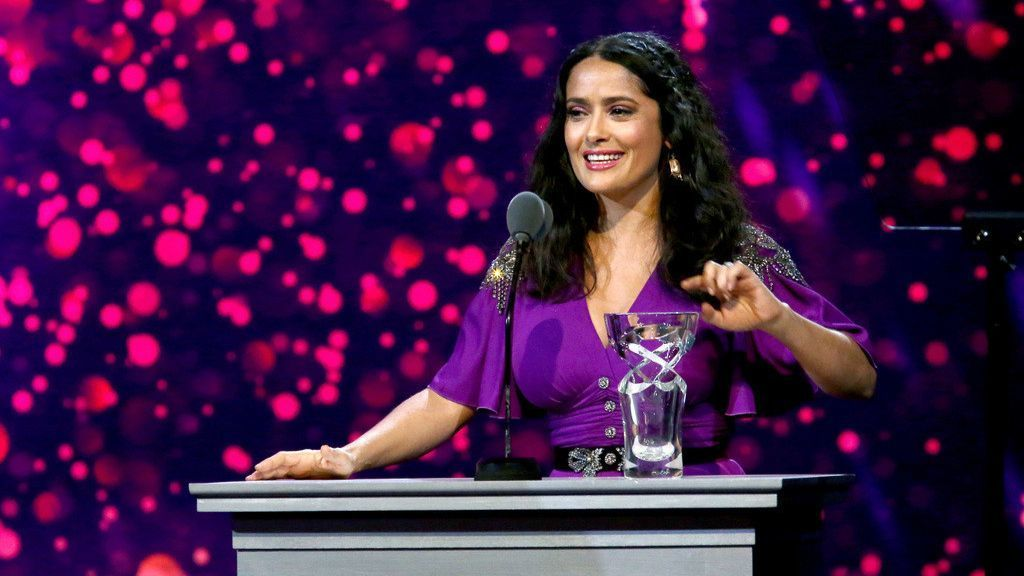 Salma Hayek Pinault, the Danny Kaye Humanitarian Leadership Award recipient, speaks onstage during the seventh biennial UNICEF Ball in Beverly Hills.