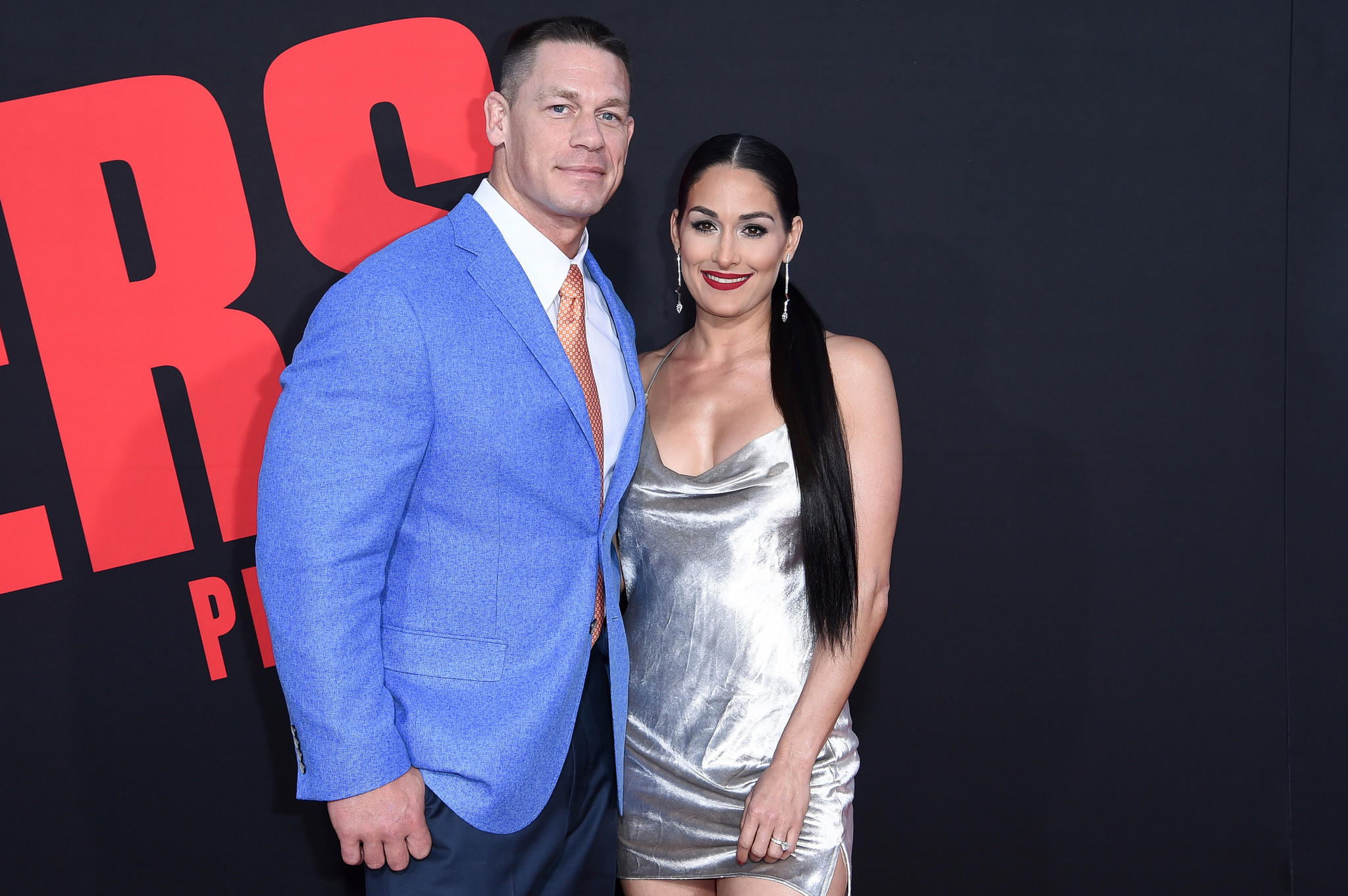 "John Cena and Nikki Bella attend the Los Angeles premiere of ""Blockers"" on April 3. (Richard Shotwell / Associated Press)"