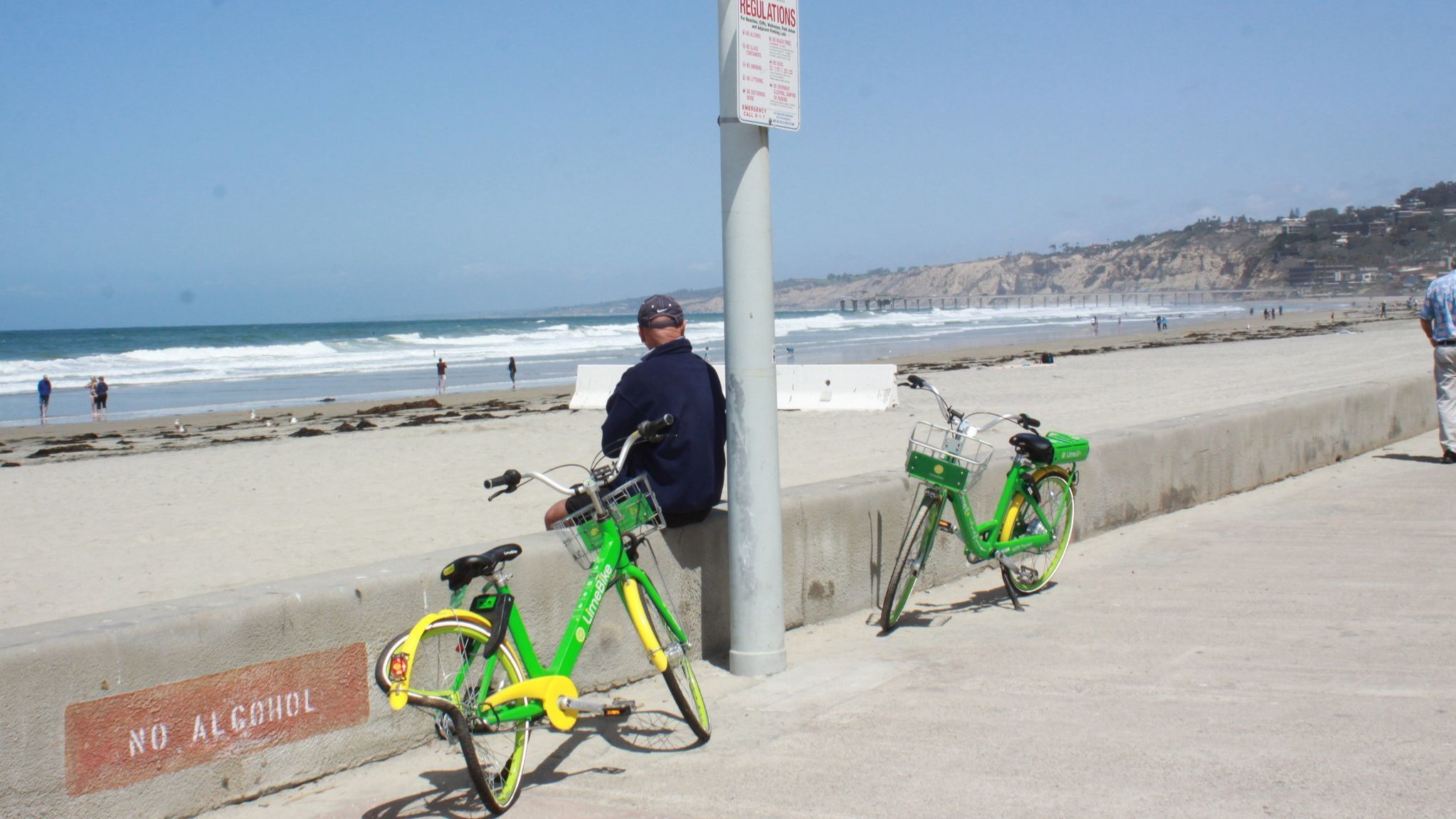 Two LimeBIkes have sat on the La Jolla Shores boardwalk, one with a damaged tire, for several days (according to resident reports).