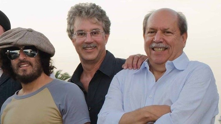 Shorenstein (middle), Barry Rosenbaum (right) and faux-Springsteen Josh Schrieber pose for a publicity photo for their former band, Thunder Road.