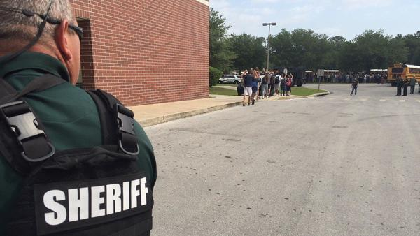 One injured, one in custody in Marion County high school shooting