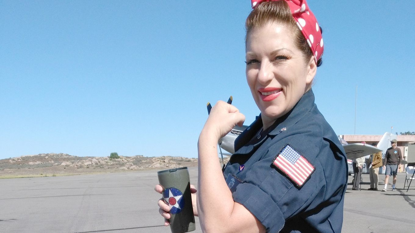 Former Marine Torri Mowery gets in the spirit of the Wings of Freedom Tour by dressing as Rosie the Riveter, an iconic symbol of women who worked in factories during WWII.