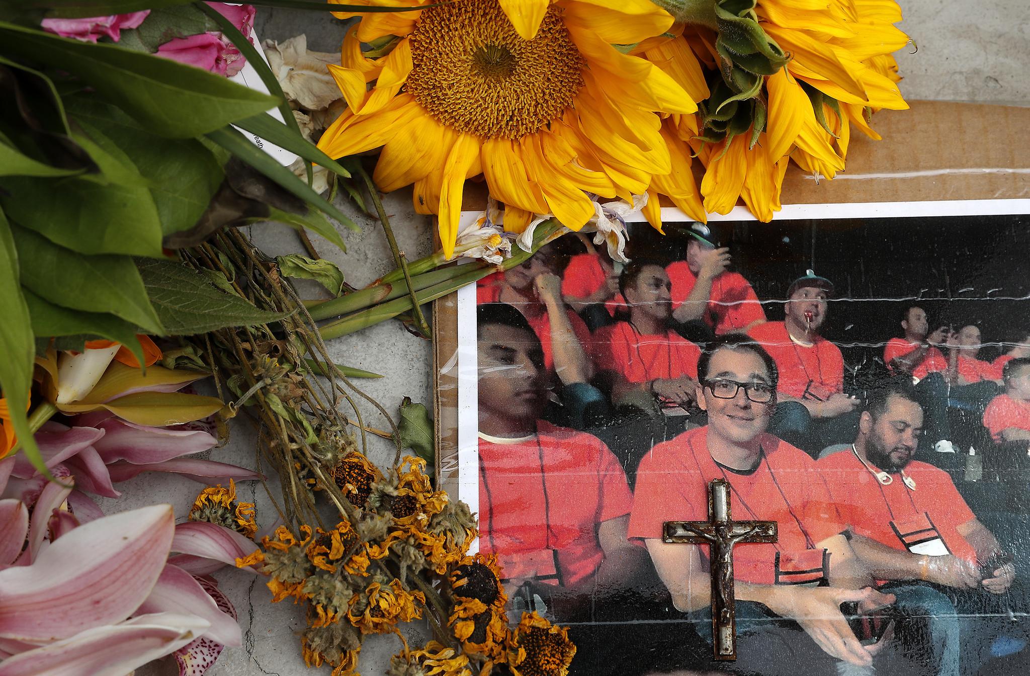 VENTURA, CA-APRIL 23, 2018: A photograph of Anthony Mele Jr., 35, (man wearing glasses) is surroun