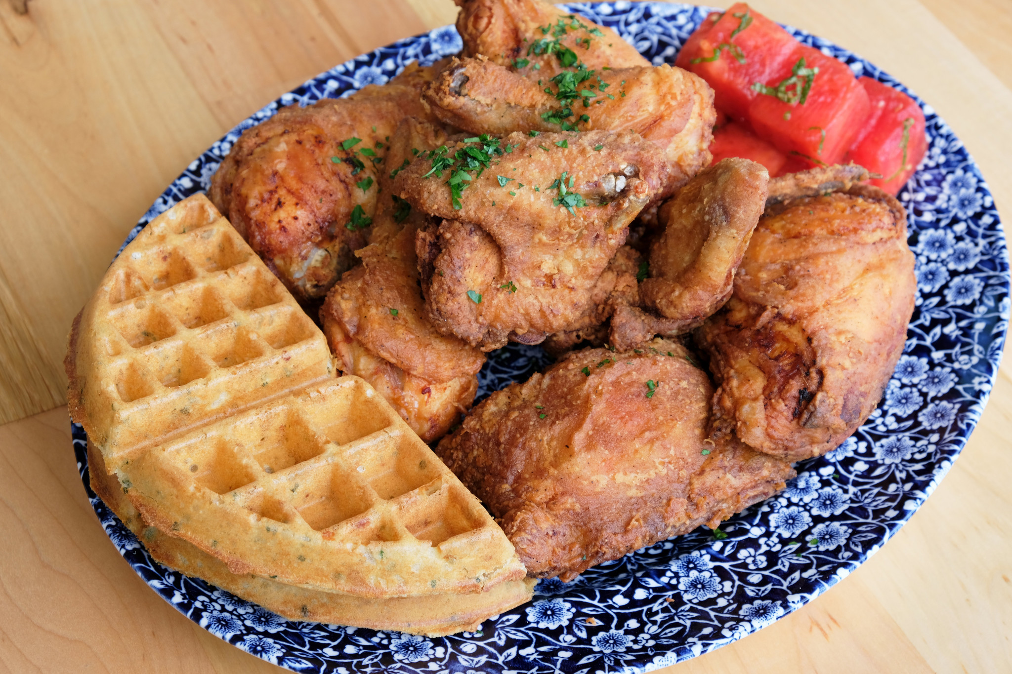 A plate of fried chicken and cheddar waffles from Yardbird Southern Table and Bar at the Beverly Cen