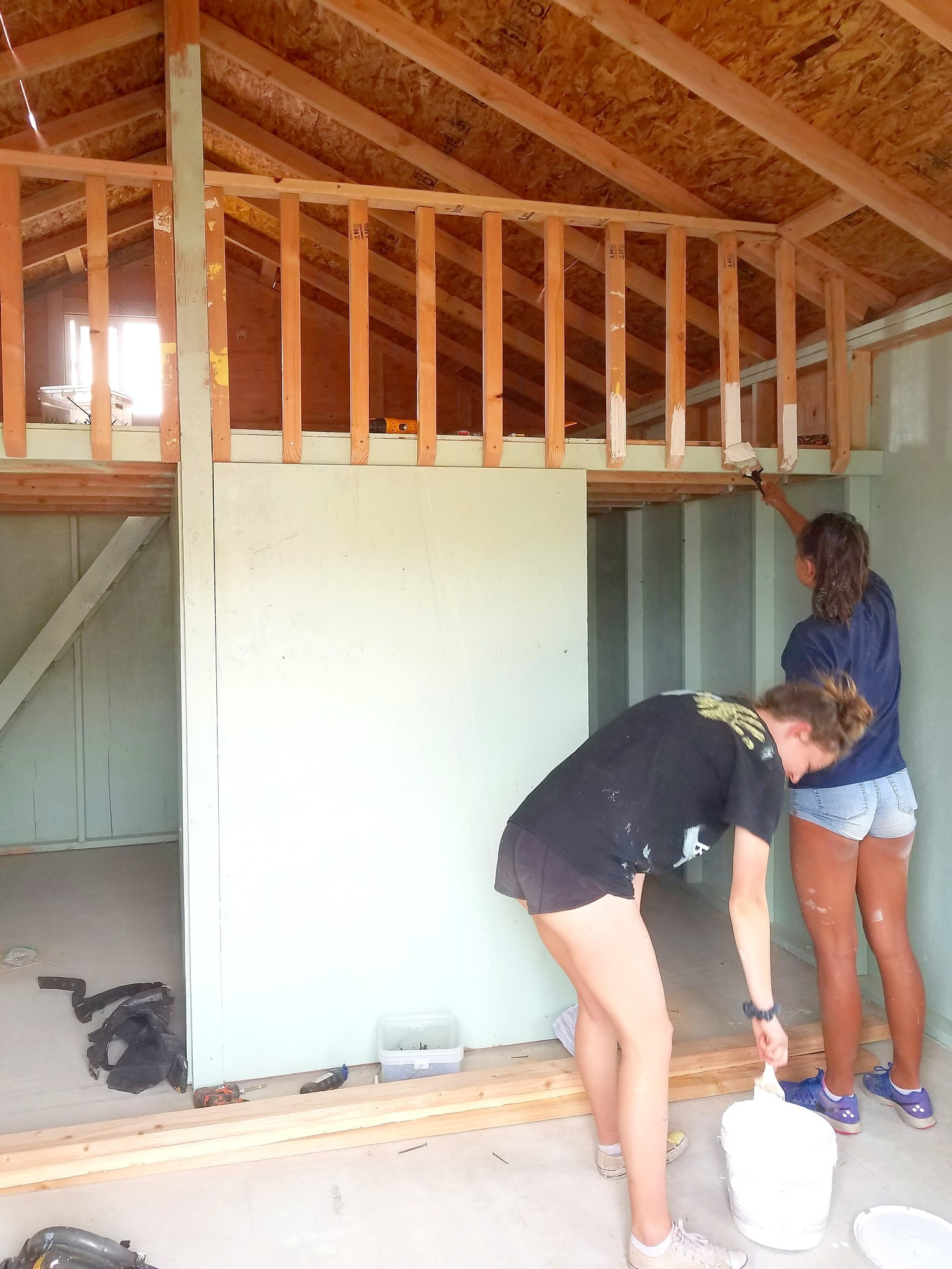 La Jolla High students paint the interior of a house.