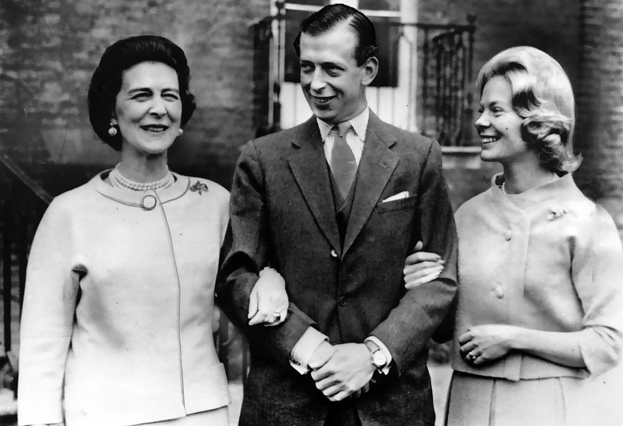 March 11, 1961: Duchess of Kent, at the left, walks with her son, Prince Edward, Duke of Kent and hi