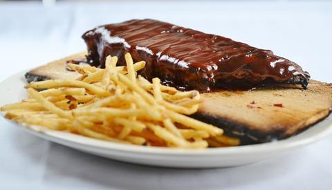 Quick-smoked barbecue ribs atMattone Restaurant + Bar,9 E 31st St, La Grange Park, IL 60526.