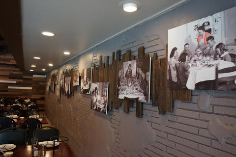 Family photos adorn the walls atMattone Restaurant + Bar,9 E 31st St, La Grange Park, IL 60526.