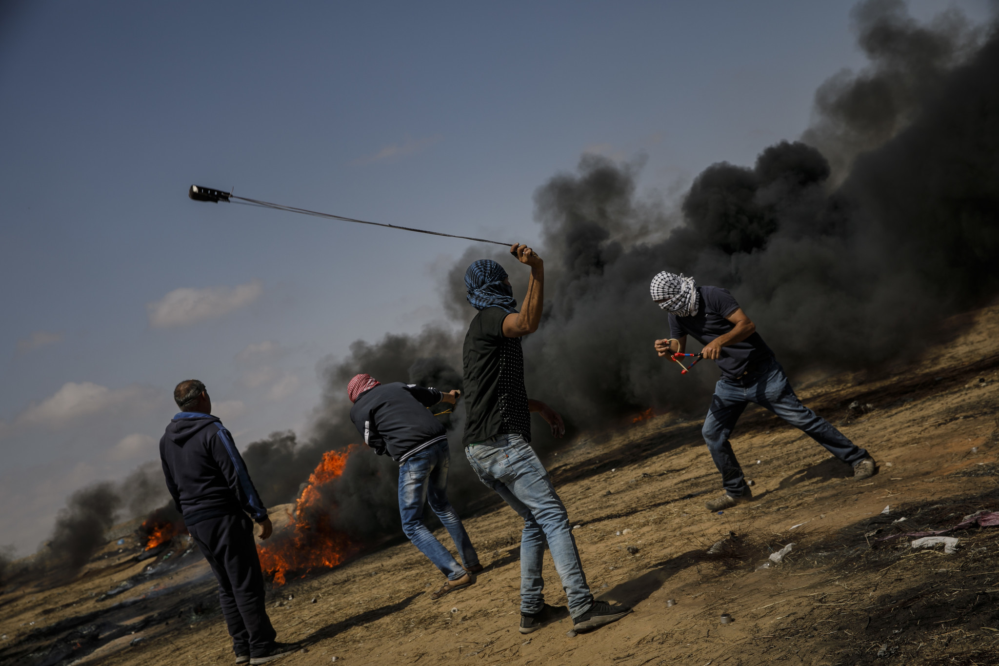 KHAN YOUNIS, GAZA STRIP — FRIDAY, MAY 11, 2018: Under the shroud of smoke from the flaming tires,