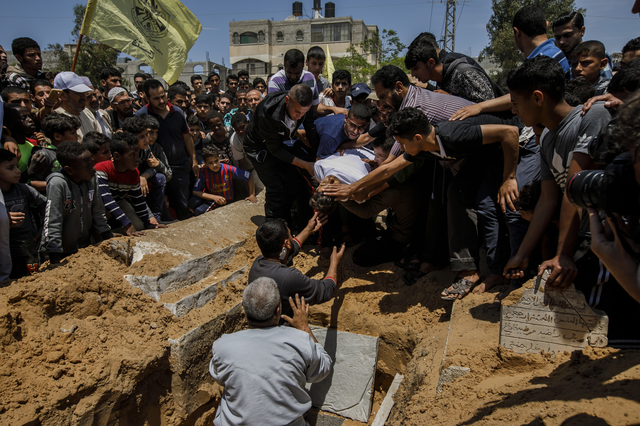 Mourners gather at a funeral service for Jamal Abdul-Rahman Affana, 15, who succumbed to his wounds sustained from last Friday's protest at the Israel-Gaza border fence in Rafah,