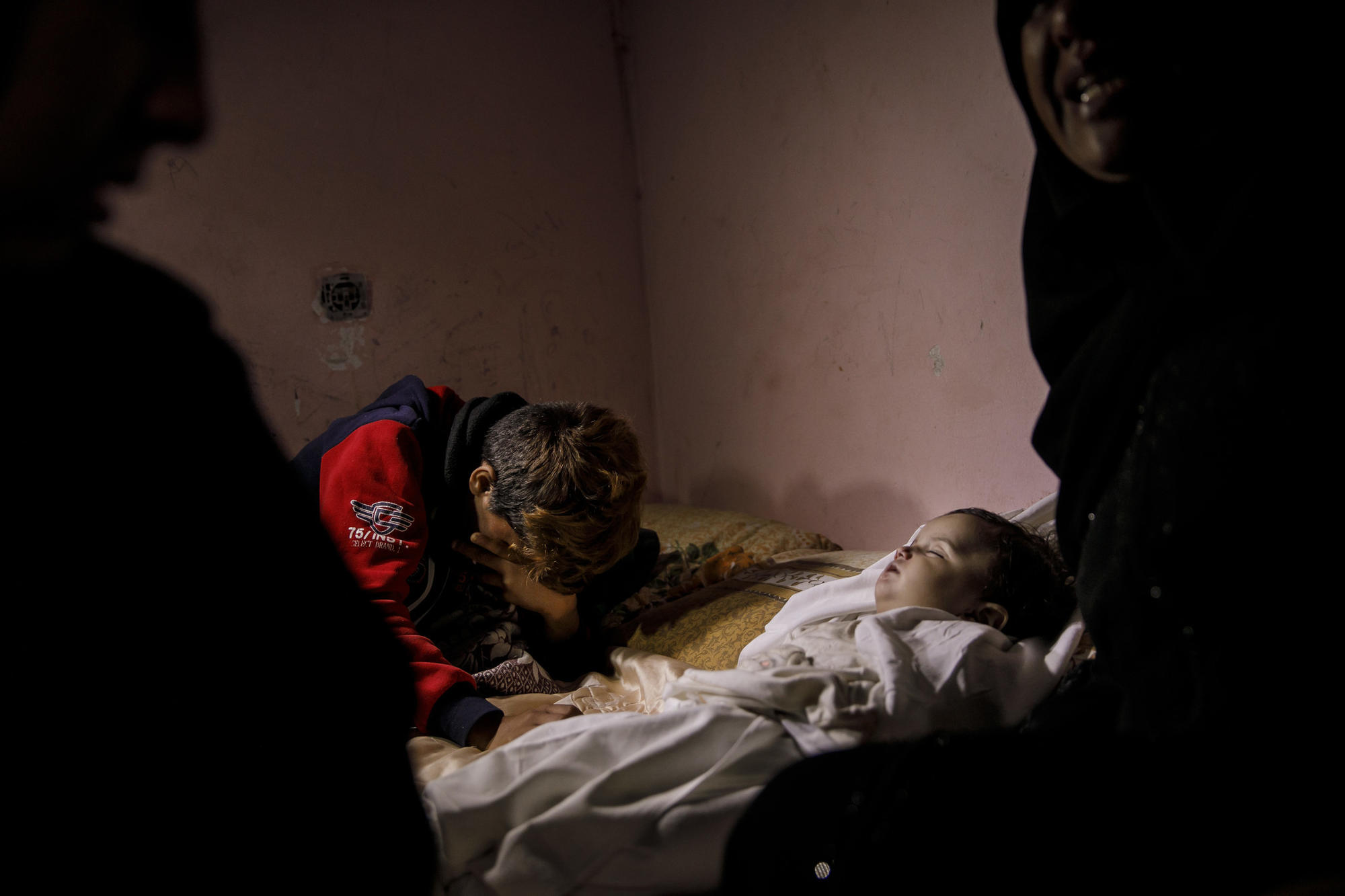 GAZA CITY, GAZA -- TUESDAY, MAY 15, 2018: Ammar, 12, grieves for his niece, Laila Anwar Ghandor, 11