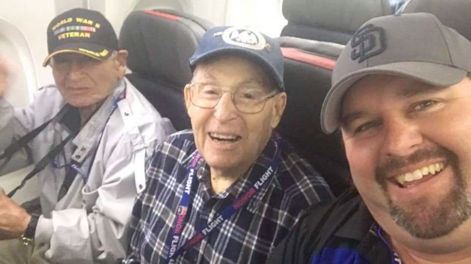 Bill Howells, center, travels to Washington, D.C., on his way to visit war memorials with a group of Honor Flight Network veterans. He sits by Robert Carrasco and David Walter.