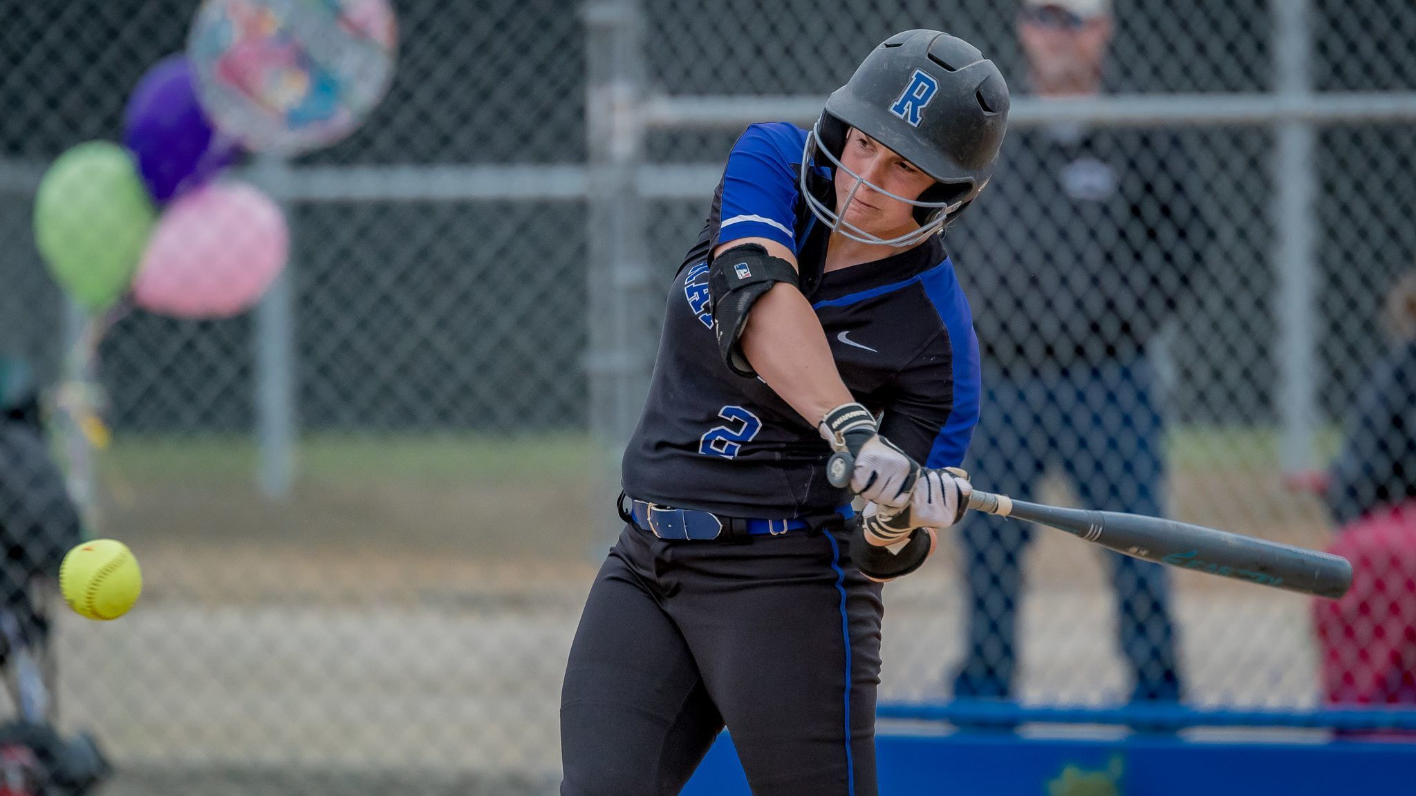 Senior Alexa Neil sends the ball into the field during the May 11 home win that ended in the bottom of the fifth due to the mercy rule.