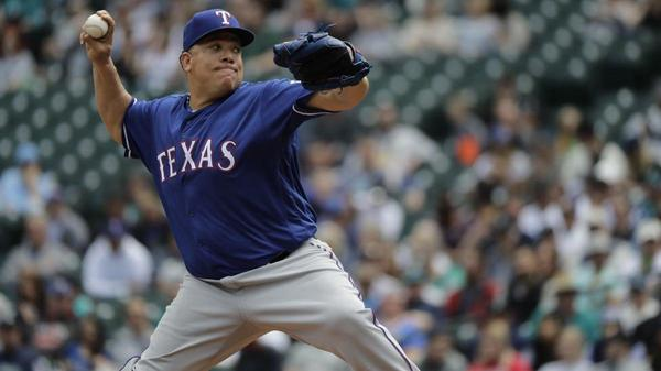 Rangers' Bartolo Colon takes a 102-mph line drive to the stomach, laughs it off