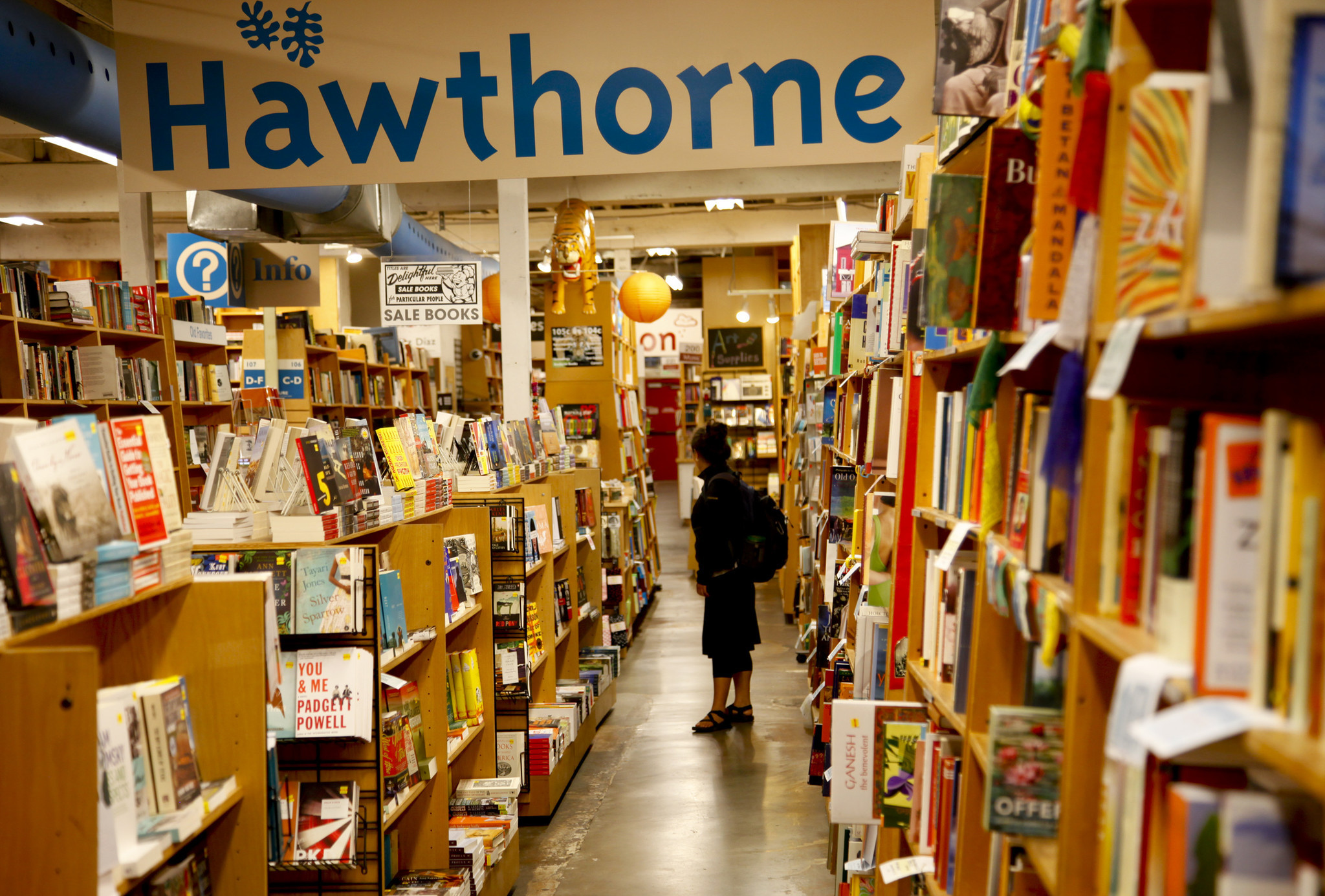 PORTLAND, OREGON, AUGUST 1, 2013 : Customer browse the shelves stuffed with books at Powell's Books