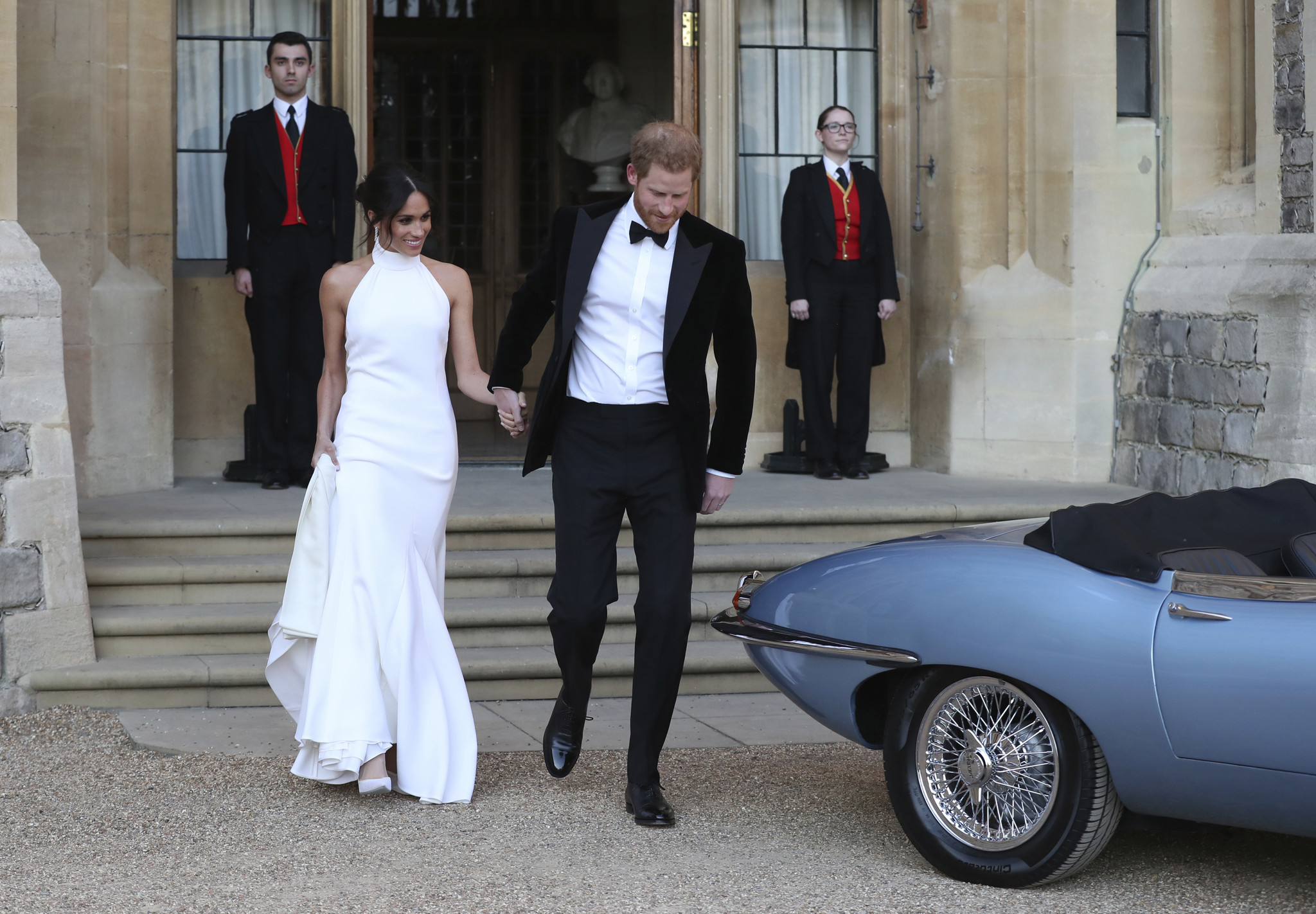 The newly married Duke and Duchess of Sussex, Meghan Markle and Prince Harry, leave Windsor Castle a