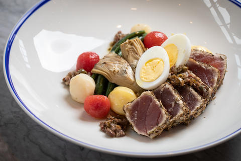 Tuna nicoise with spiced tuna, marinated potato, egg, tomato and green beans.