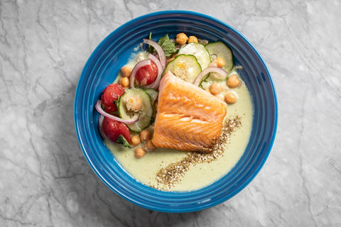 Roasted salmon with marinated garbanzo beans, cucumber and gazpacho.