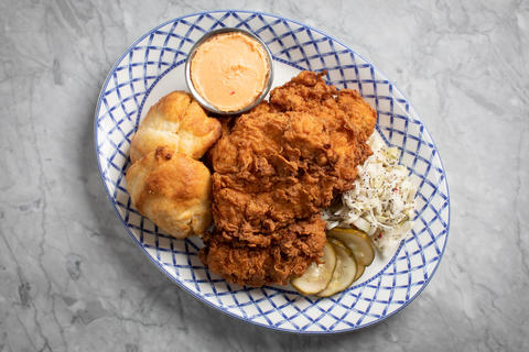 Fried chicken with cornmeal biscuit, pimento cheese and poppyseed slaw.