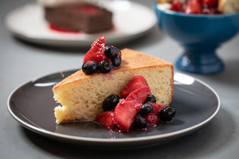 Tres leches cake with mixed berry compote.