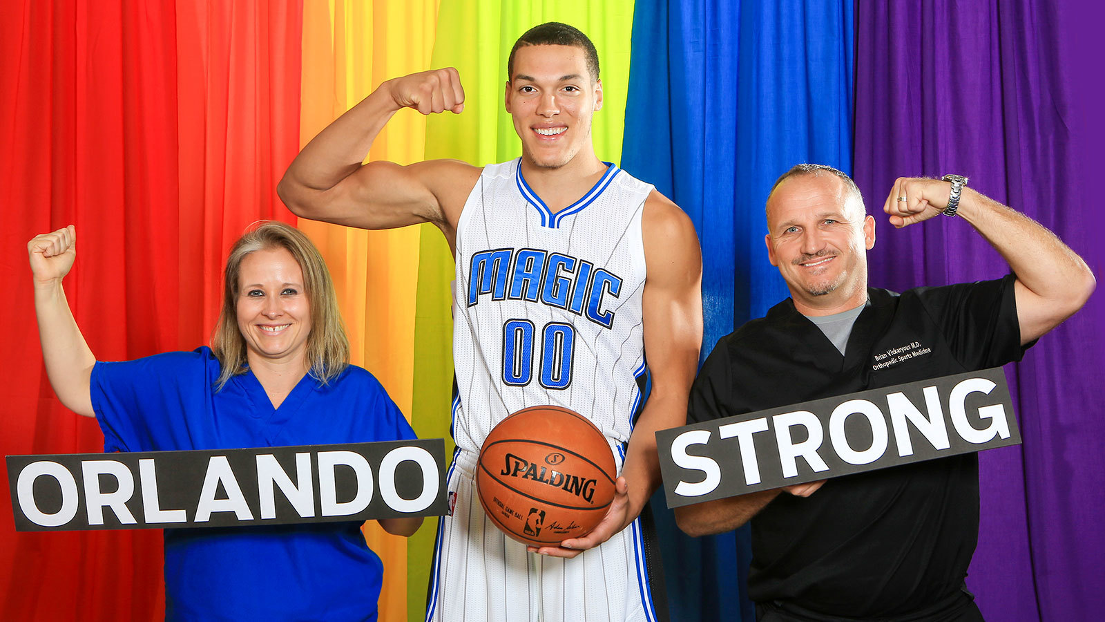 Orlando Magic forward Aaron Gordon with nurse Jessica Mills and Dr. Brian Vickaryous of Florida Hospital Orlando