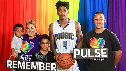 Orlando Magic point guard Elfrid Payton with the family of Pulse shooting victim Peter O. Gonzalez