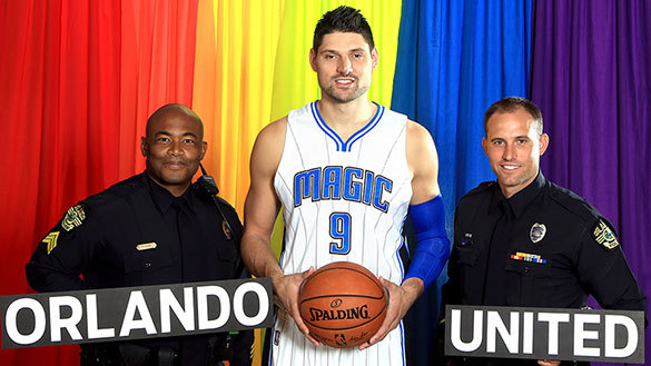 Orlando Magic center Nikola Vucevic with Sgt. Ira Morris and Officer Ben Chisari, Orlando Police Department