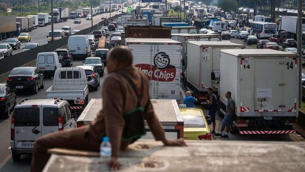 Brazilian president sends in troops to remove blockages as truck strike paralyzes nation