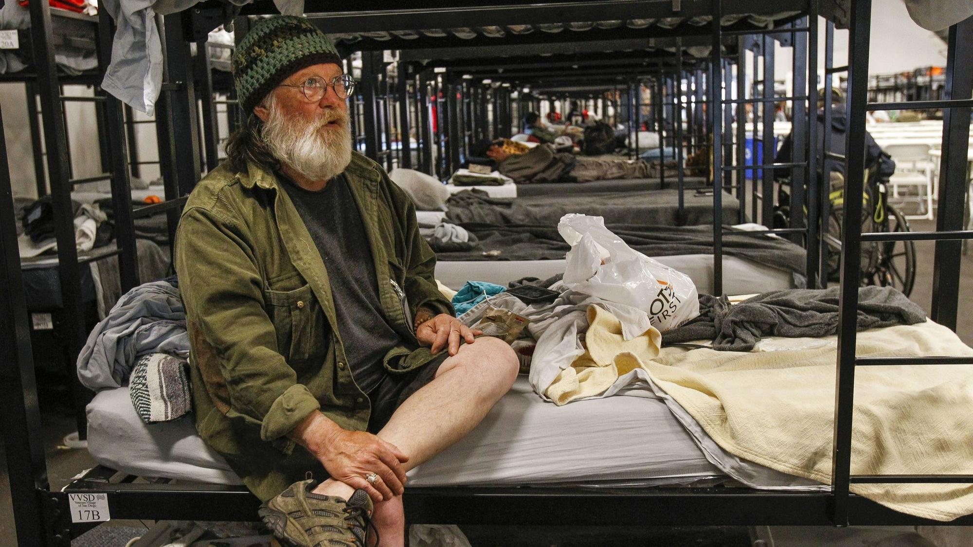SAN DIEGO, May 24, 2018 | Jeffrey Bennatts, 70, a Navy veteran, sits on his bed at a shelter tent fo