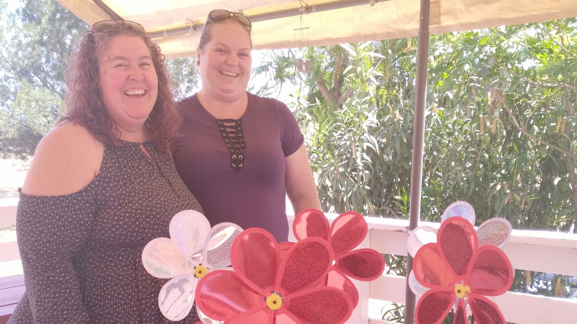 Michael's House Executive Director Rhea Tabler, left, and Backup Administrator Chelsea Clark admire centerpieces they created for the nonprofit's 40-year anniversary celebrations.