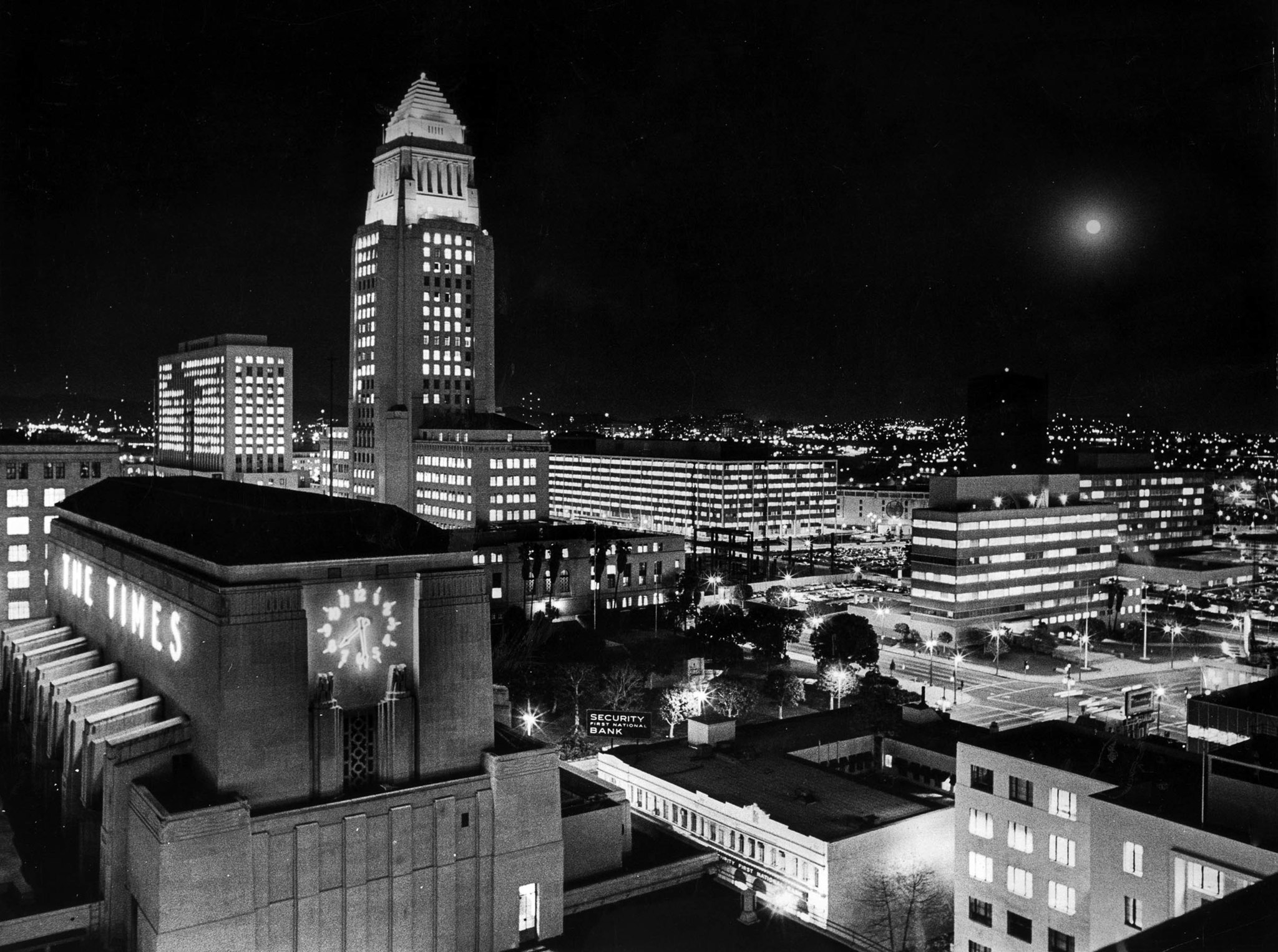Feb. 4, 1969: Los Angeles City Hall and Los Angeles Times building at night. A full moon is on the r