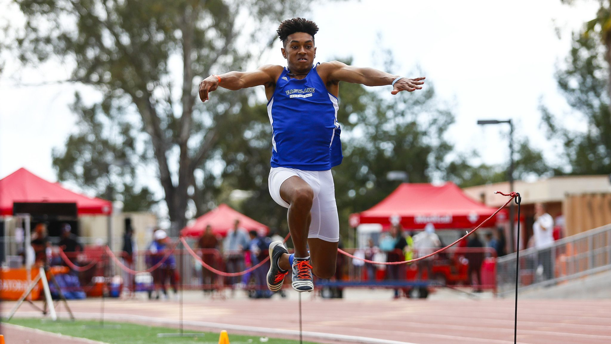 Eastlake's Jalyn Jackson completes a run in the boys triple jump.