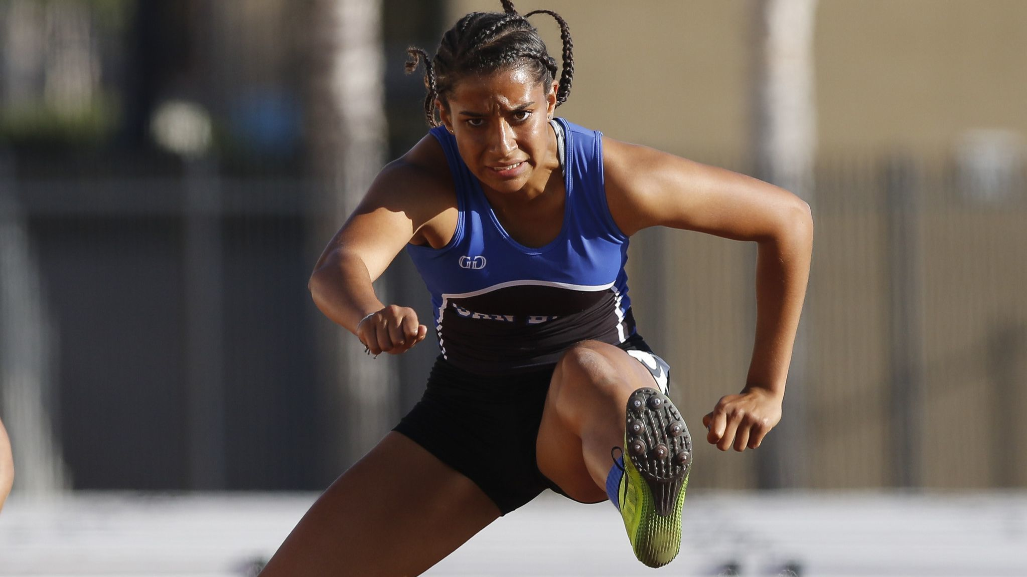 San Diego's Sonia Redon clears the last hurdle on her win in the girls 100 meter hurdles at the Esco